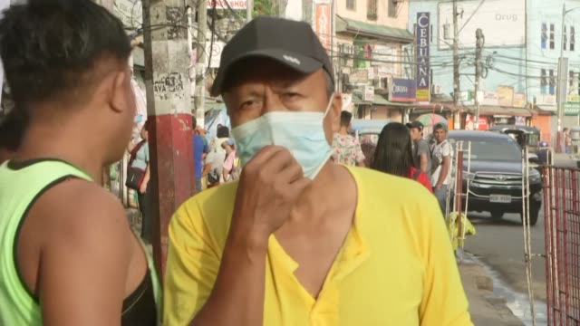 as taal volcano in the south of the philippine capital spews ash residents in metro manila are affected and are wearing face masks - taal volcano stock videos & royalty-free footage