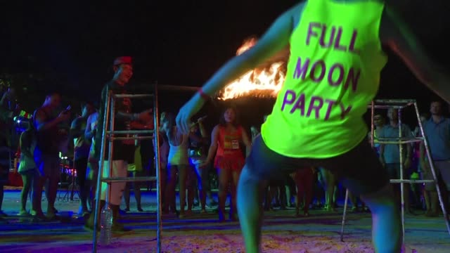 as thailand enters peak tourist season thousands of revellers from around the world attend the famous full moon party on the island of ko phangan - ko phangan stock videos and b-roll footage