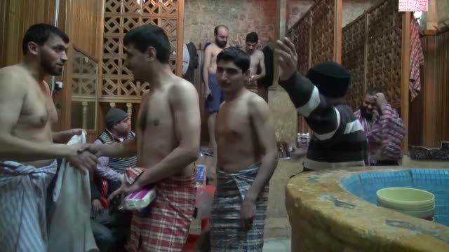as the conflict in syria rages on for a fifth year residents in the northern city of aleppo try to find ways to relax and entertain themselves that... - bathhouse stock videos & royalty-free footage