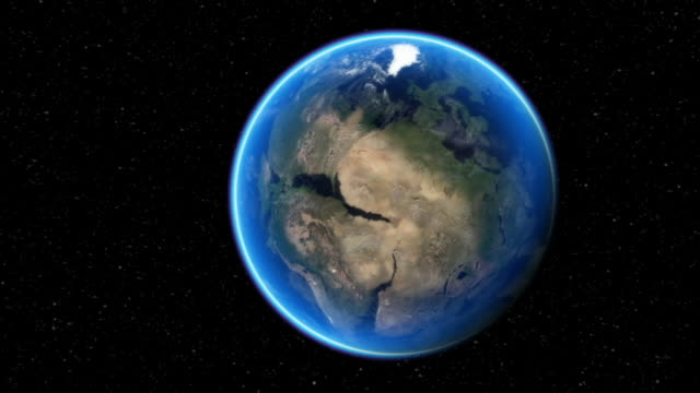 as the earth rotates, the land separates into continents and clouds cover the skies. - evoluzione video stock e b–roll