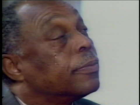 as the jury acquits the police officers charged with using excessive force in arresting rodney king a year earlier, reverend cecil l. murray sheds a... - black history in the us stock videos & royalty-free footage