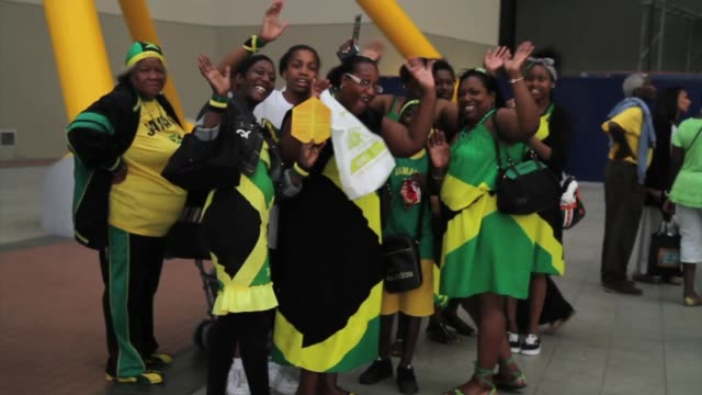 as the london olympics 2012 came to an end crowds of people turned out to mark the closing ceremony at jamaica house hundreds of people queued inside... - emma brumpton stock videos & royalty-free footage