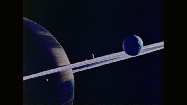 as the outer planets of the solar system float by, isaac asimov explains how the pioneer 10 probe carries images of humans and details of human life... - solar system stock videos & royalty-free footage