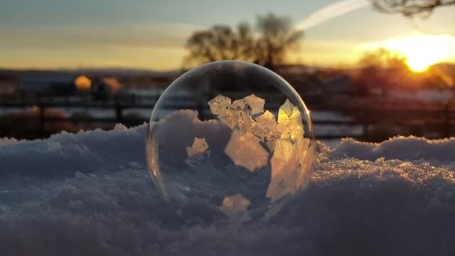 as the sun rose on tanya stafford's backyard in reno, nevada, she dropped soapy liquid on snow to create a bubble. in the frigid outside air, ice... - soap sud stock videos & royalty-free footage