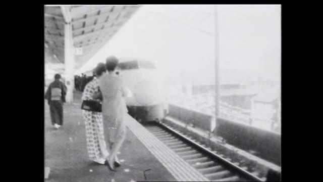 as the tokaido shinkansen begins services the first hikari train arrives at the platform of the nagoya station - shinkansen stock videos & royalty-free footage
