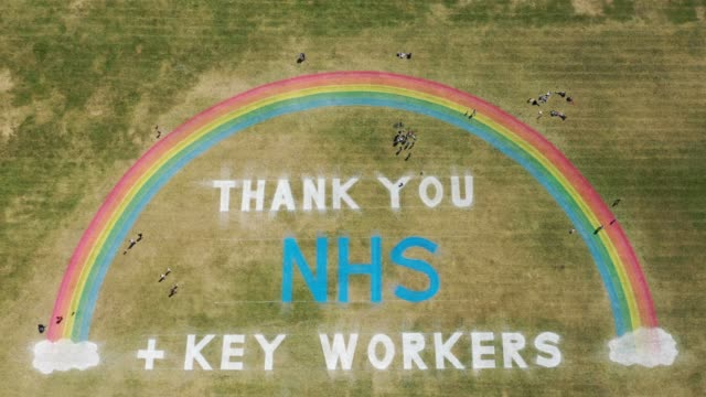 as the uk government ease lockdown restrictions people exercise and view a giant rainbow mural created by wirral council to thank nhs and key workers... - thank you englischer satz stock-videos und b-roll-filmmaterial