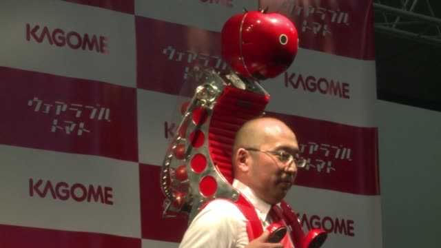 as the world's electronic companies scramble to set the agenda for wearable devices one japanese vegetable juice maker goes one better unveiling a... - tomato juice stock videos and b-roll footage