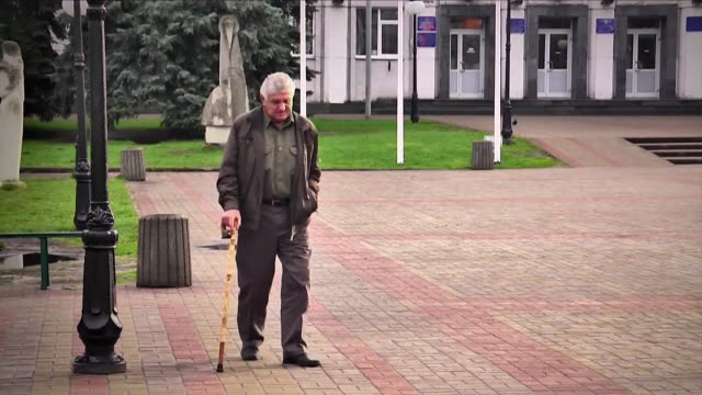 stockvideo's en b-roll-footage met as ukraine prepares to mark 30 years since the chernobyl nuclear disaster a former plant worker who became one of some 600000 people known as... - fall out