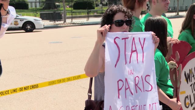As US President Donald Trump announces protestors gather in Lafayette Park to demonstrate against his decision to leave the Paris Climate Accord