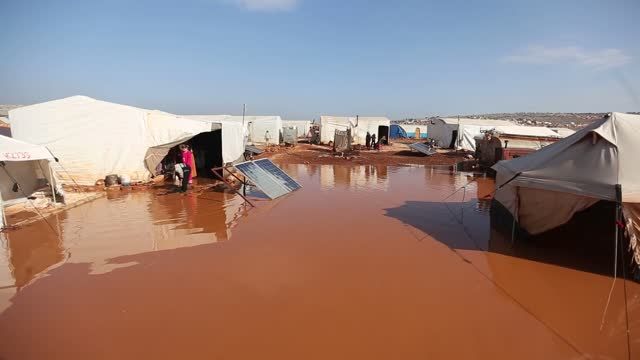 as winter comes with added vulnerability after years of violence against syrian refugees about 500 tents at a refugee camp were covered with mud... - hygiene stock videos & royalty-free footage