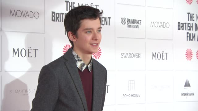 asa butterfield at the moet british independent film awards 2014 at old billingsgate market on december 07 2014 in london england - audio electronics stock videos & royalty-free footage