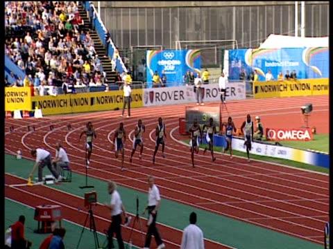 asafa powell winning heat 1 of men's 100m, 2004 crystal palace athletics grand prix, london - ヒート点の映像素材/bロール