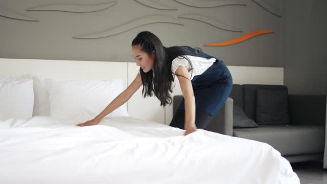 asain maid making bed at hotel room. - neat stock videos & royalty-free footage