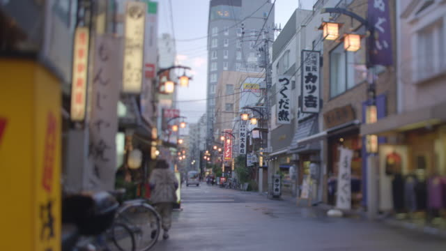 asakusa sidestreet w rickshaws. - rickshaw stock videos and b-roll footage