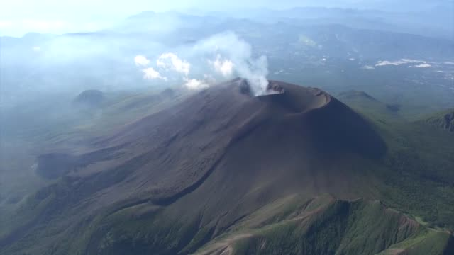movie taken aug 8 from a kyodo news helicopter shows a crater of japan's mt asama straddling gunma and nagano prefectures following a small eruption... - honshu stock videos and b-roll footage