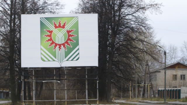 asbest town crest on sign depicting asbestos fibers unburnt by ring of fire, pan - asbest stock-videos und b-roll-filmmaterial