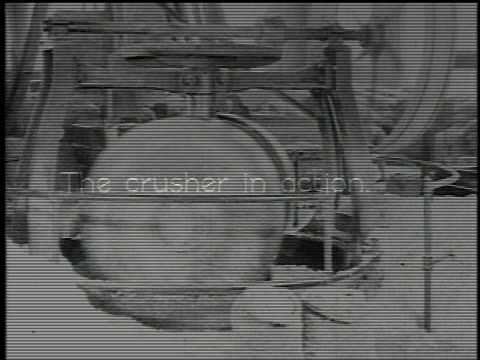 1921 montage asbestos crusher turning and a comparison of 200 pounds of rock before and after the crushing process / waukegan, illinois, united states - 1921 stock-videos und b-roll-filmmaterial