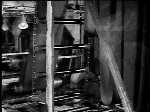 1921 montage asbestos paper mill machinery / united states - 1921年点の映像素材/bロール