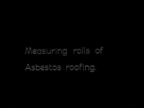 1921 MONTAGE Asbestos paper mill with workers measuring, cutting, and rolling it for roofing material / United States