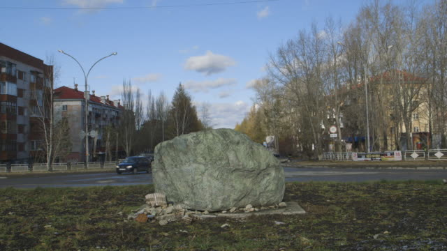 asbestos rock monument in town of asbest, wide shot - asbest stock-videos und b-roll-filmmaterial