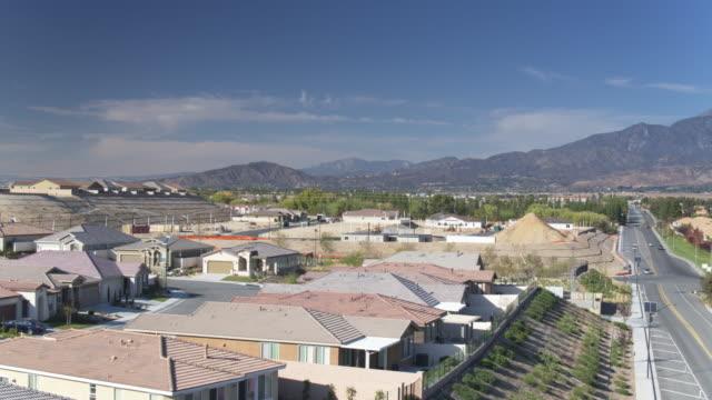 ascending aerial establishing shot of an expanding california suburb - riverside california stock videos and b-roll footage
