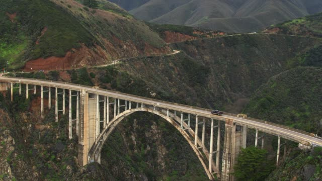 ascending aerial of bixby creek bridge - bixby creek bridge stock videos & royalty-free footage