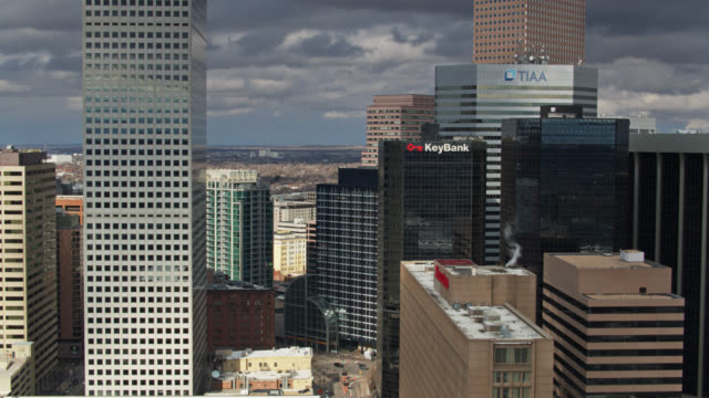 ascending aerial of downtown denver in early spring - denver stock videos & royalty-free footage