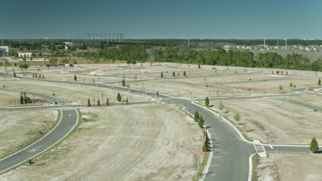 ascending aerial shot of land graded for new houses - mittelschicht stereotypen stock-videos und b-roll-filmmaterial