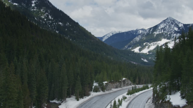 ascending aerial shot of us route 2 in stevens pass, washington - pacific crest trail stock videos & royalty-free footage