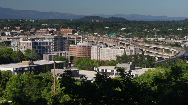 ascending aerial view of portland with mt tabor in distance - portland oregon sunset stock videos & royalty-free footage