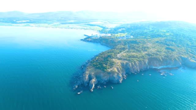 Ascending drone aerial shot revealing beautiful landscape near the sea