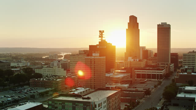 ascending drone flight over downtown omaha revealing rising sun and missouri river - horizon stock videos & royalty-free footage