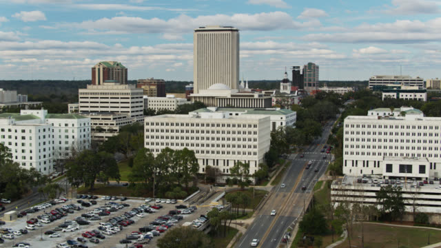 ascending drone of the state capitol complex in tallahassee, florida - florida us state stock videos & royalty-free footage