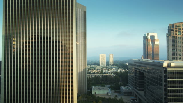 ascending drone shot of century city, los angeles - tilt up stock videos & royalty-free footage