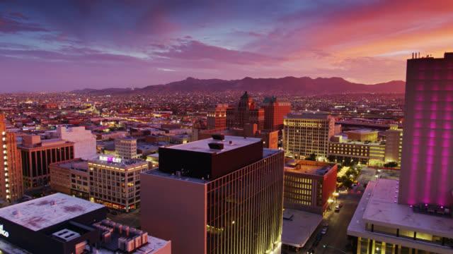 ascending drone shot of el paso and ciudad juárez at sunset - el paso texas stock videos & royalty-free footage