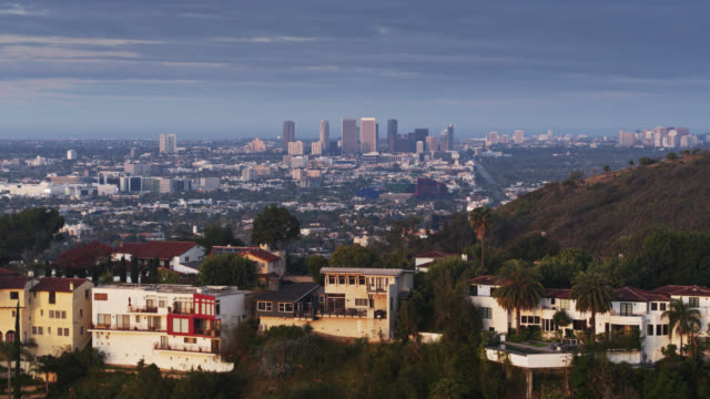 ascending drone shot of hollywood hills houses and century city at dawn - century city stock videos & royalty-free footage