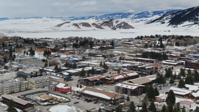 ascending drone shot of jackson, wyoming mit national elk refuge im hintergrund - jackson hole stock-videos und b-roll-filmmaterial