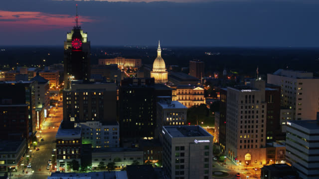 ascending drone shot of lansing, michigan revealing state capitol dome at night - lansing stock videos & royalty-free footage