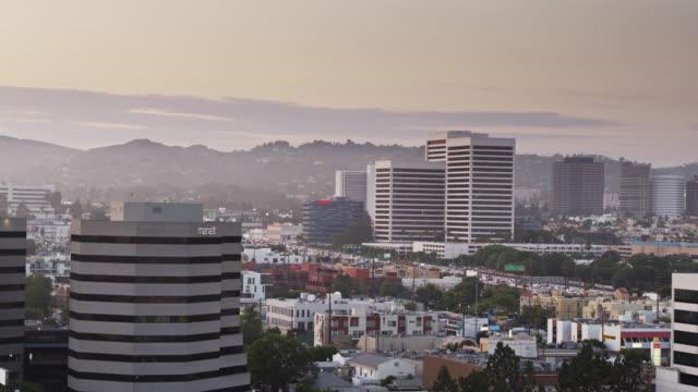 ascending drone shot of los angeles looking north towards westwood - westwood neighborhood los angeles stock videos & royalty-free footage