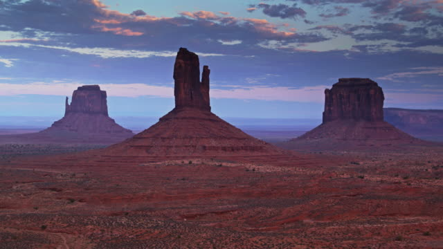 ascending drone shot of mitten and merrick buttes, monument valley - navajo reservation stock videos and b-roll footage