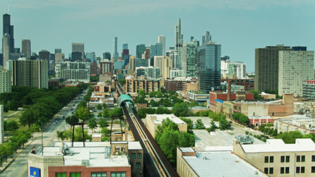 ascending drone shot of near south side and downtown chicago - chicago 'l' stock videos & royalty-free footage