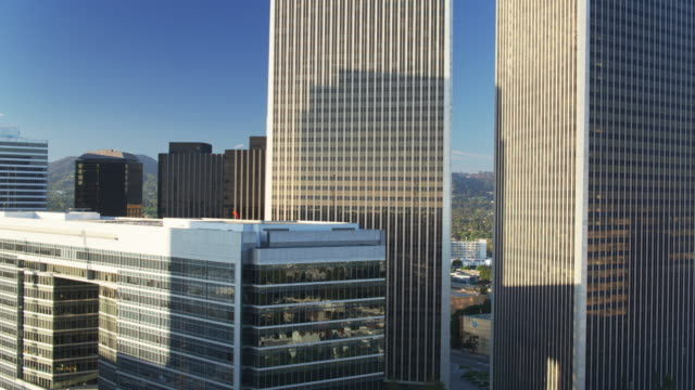 ascending drone shot of office towers in century city, los angeles - century city stock videos & royalty-free footage