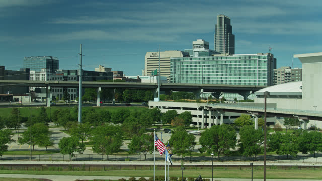 ascending drone shot of omaha from riverfront - auditorium stock videos & royalty-free footage