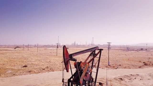 ascending drone shot of pumpjack in midway-sunset oil field, california - fossil fuel stock videos & royalty-free footage