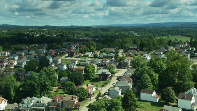 ascending drone shot of residential neighborhood in uniontown, pennsylvania and landscape beyond - residential district stock videos & royalty-free footage