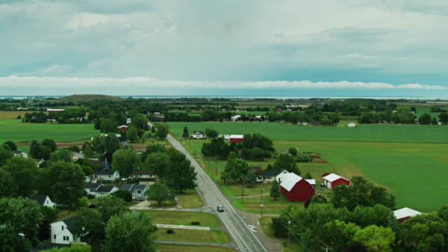 ascending drone shot of rural landscape and small town on edge of lake erie - michigan stock videos & royalty-free footage