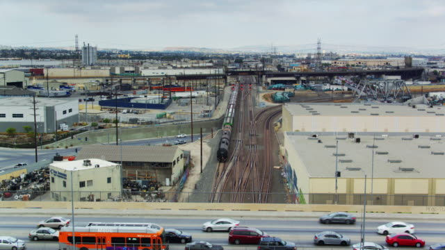 ascending drone shot of the alameda freight corridor, los angeles - rail freight stock videos and b-roll footage