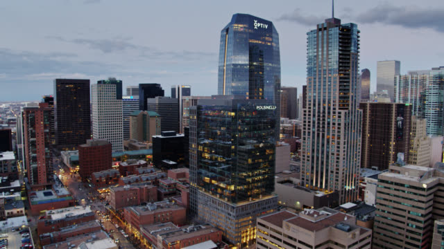 ascending drone shot of the downtown denver skyline at dusk - colorado stock videos & royalty-free footage