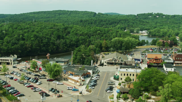 ascending drone shot of the town of wisconsin dells on the banks of the wisconsin river - street name sign stock videos & royalty-free footage