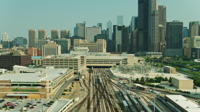 ascending drone shot of train tracks headed towards downtown chicago - willis tower stock videos & royalty-free footage